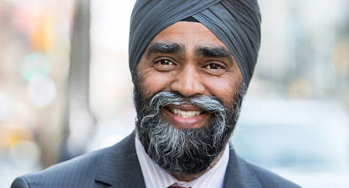 How can Trudeau allow Sajjan to remain in cabinet?